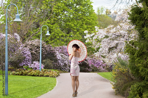Beautiful Chinese girl at spring scene in public city garden