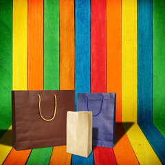 shopping bags on colorful wood Background
