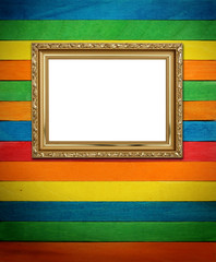 Gold frame on colorful wood Background