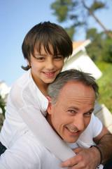 Dad giving son piggyback