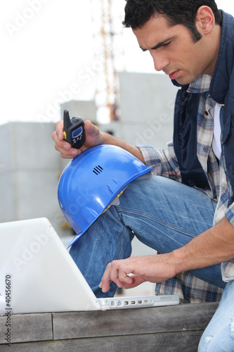 Foreman with radio and computer