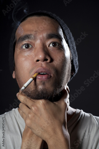 Head shot of a sick smoker