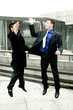 Two men in business suit giving high five.