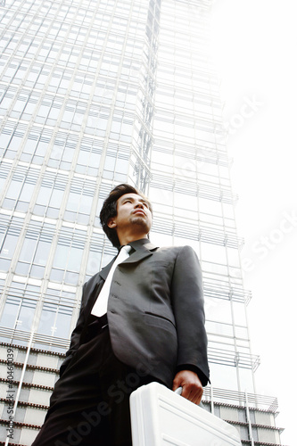 Man in business suit carrying a briefcase.