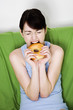 Woman biting on a doughnut.