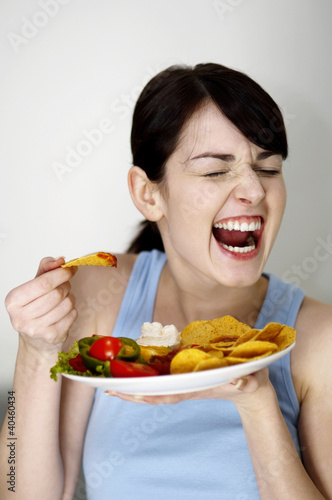 Woman eating chips.