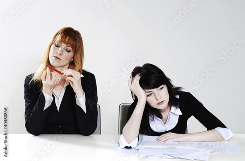 Businesswomen feeling lazy.