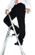 Businessman standing on top of a ladder.