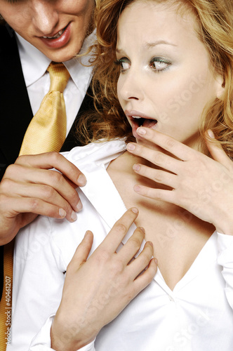 Businesswoman shocked with her colleague's behavior.