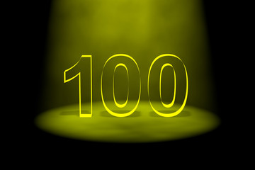 Number 100 illuminated with yellow light