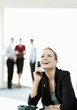 Businesswoman laughing while talking on the phone.