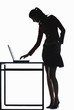 Silhouette of businesswoman using laptop.