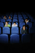 Teenagers watching movie in cinema.