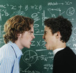 Two boys arguing in the classroom.
