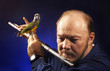 Man playing flute with bird on it