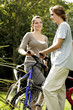 Young man and woman on cycling excursion