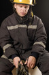 Fire fighter holding protective gloves