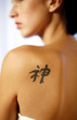 Woman with a chinese character tattoo on her back