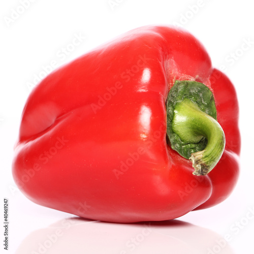 Red paprika over white background