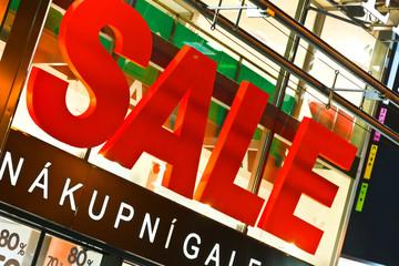 Big sale sign above store entrance
