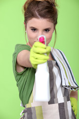 girl holding detergent with pistol pump