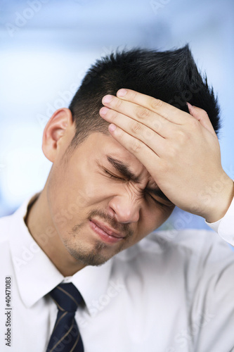 Businessman with his hand on forehead
