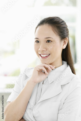 Female doctor smiling while looking away