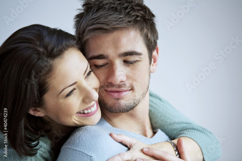 Woman hugging her boyfriend from behind