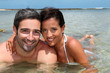 Cheerful couple relaxing in lagoon water