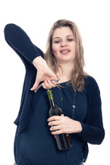 Drunk woman opening bottle of wine