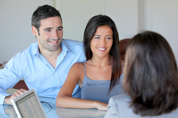 Couple meeting financial adviser for investment