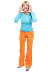 Middle age woman shouting through megaphone shaped hands