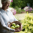 Senior woman holding a basket of fruits