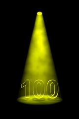 Number 100 illuminated with yellow spotlight