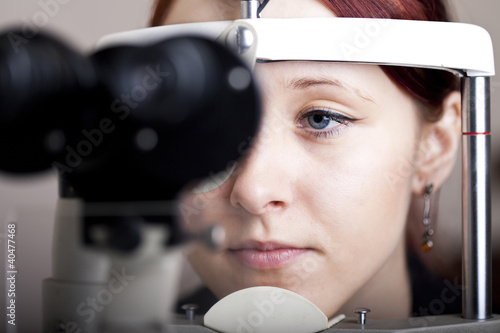 Beautiful young woman having eye test