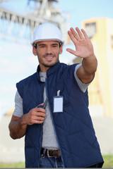 Foreman performing stop gesture