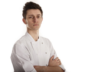 Chef wearing white jacket with folded arms