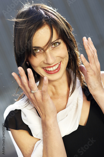 Portrait of Surprised Graceful Woman, hands up