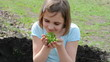child with a plant outdoor