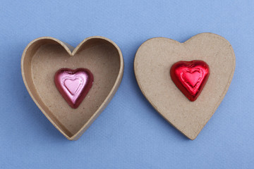 Paper and chocolate hearts