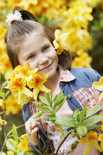 Girl with blossoms of rhododendron