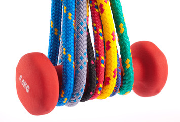 fitness barbell and colorful strings