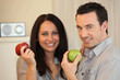 Couple eating apples