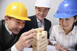 Business people playing wooden blocks game