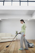 Woman vacuuming the floor