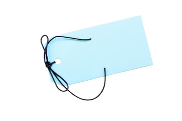 Blank blue tag with dark blue cord on white with copy space.
