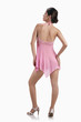 Woman in pink multi-fibre halter-neck chemise