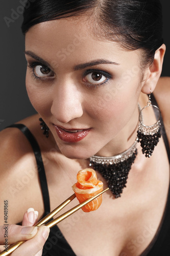 Woman eating salmon sashimi