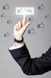 business man hand pressing Social network icon