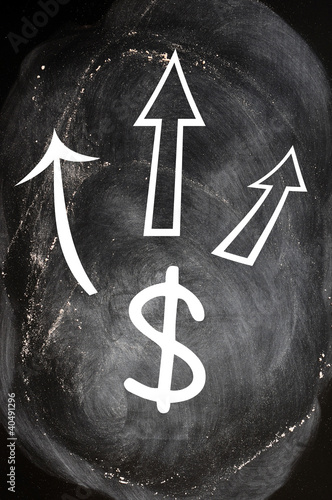 US Dollar symbol with up arrows on blackboard
